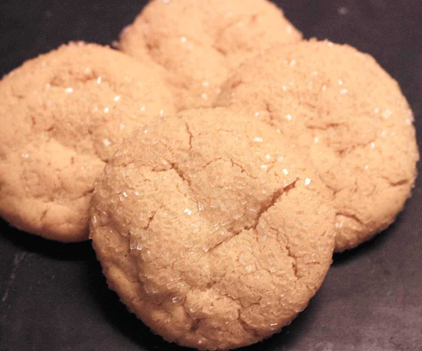 Crinkly tops of chewy sugar cookies