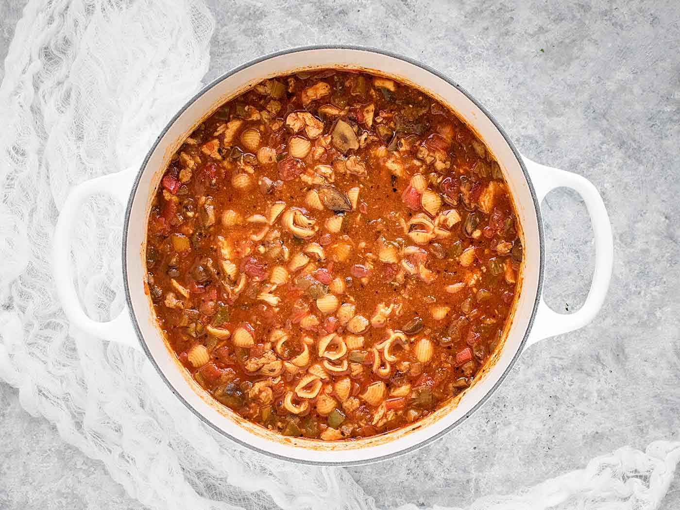 Chicken Chili Soup in a white Dutch oven, ready to serve