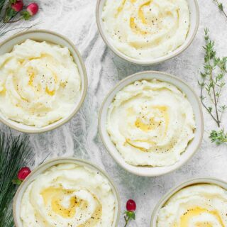 Single serving bowls of Roasted Garlic Mashed Potatoes