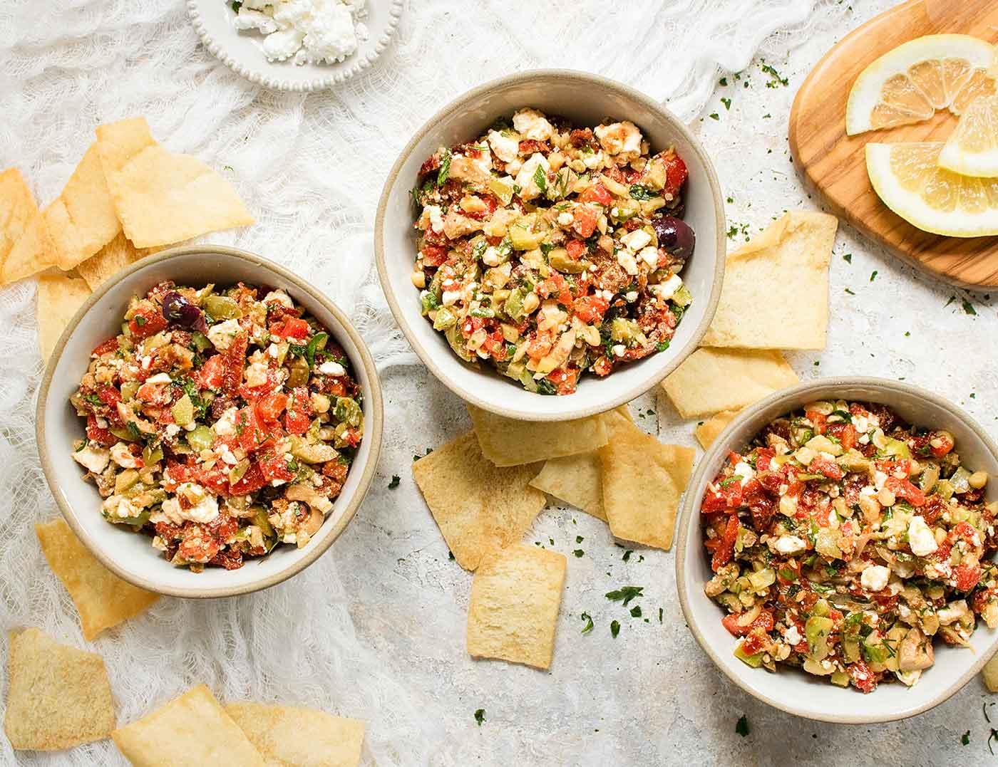 Three bowls of Mediterranean Salsa with pita chips