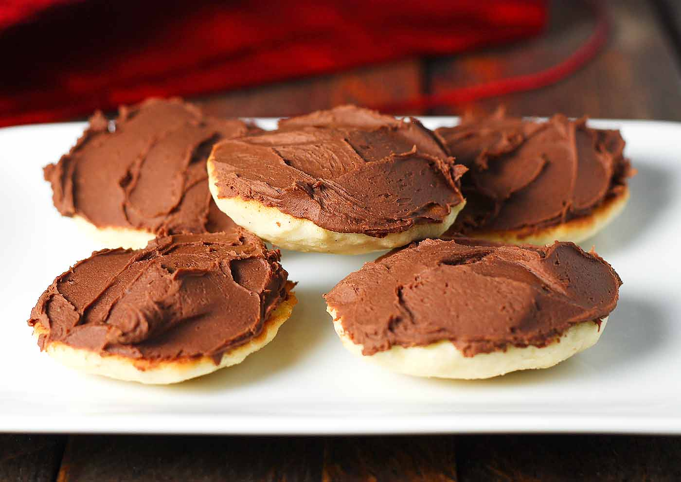 A stack of five Berger Cookies on a white plate