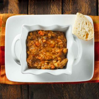 Rustic Lentil Soup in a square white bowl