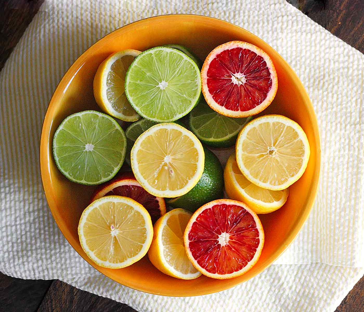 Lemons, limes and blood oranges ready to squeeze for homemade sour mix