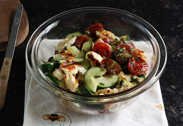 Grilled tomato, halloumi + cucumber salad