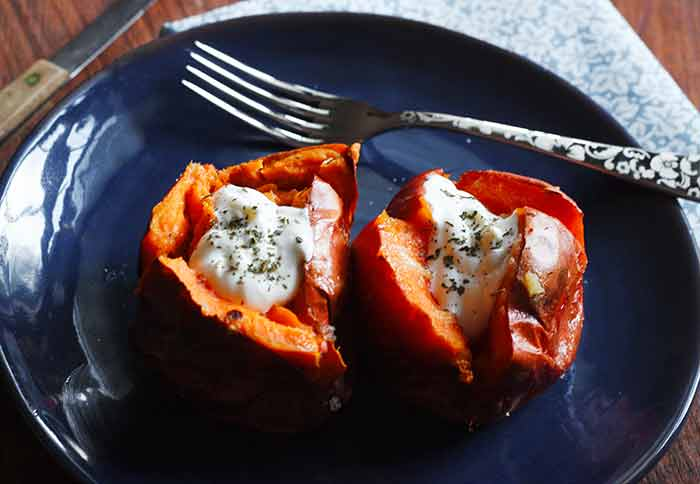 Salt roasted sweet potatoes topped with sour cream