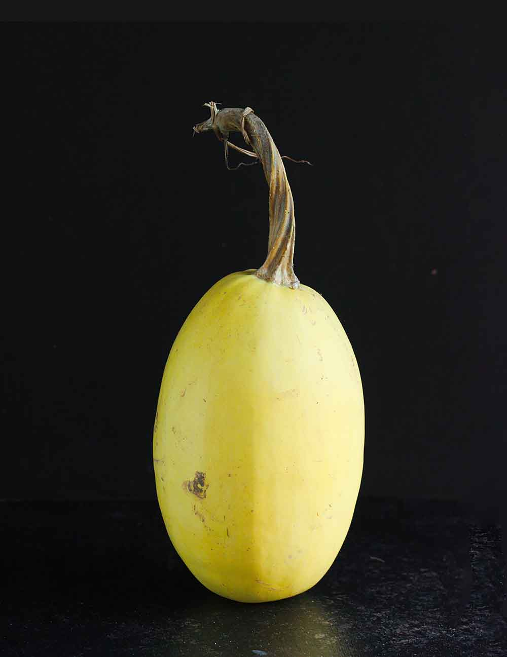 Portrait of a spaghetti squash, before preparing shrimp and vegetables over spaghetti squash.