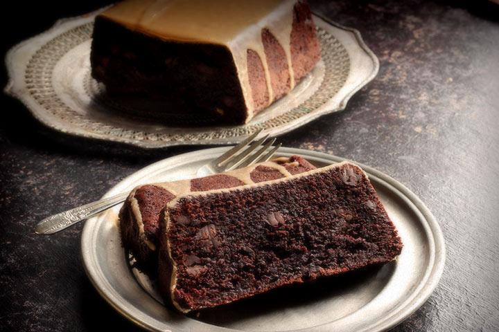 A slice of Chocolate Chocolate Chip Cake with Kahlua Icing