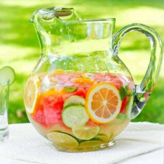 Homemade vitamin water, fruit infused water in a pitcher | Recipe at SoupAddict.com