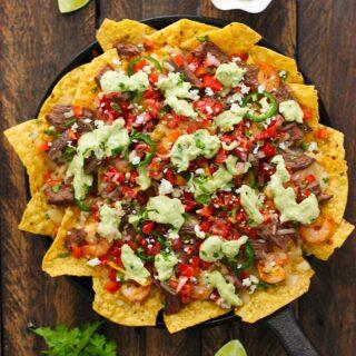 Grilled surf 'n turf nachos in a skillet