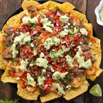 Grilled Surf 'n Turf Party Nachos with Avocado Cotija Sauce and Margarita Pico de Gallo from SoupAddict.com. Summer party nachos topped with addictive avocado cotija sauce and fresh tequilla spiked pico de gallo.