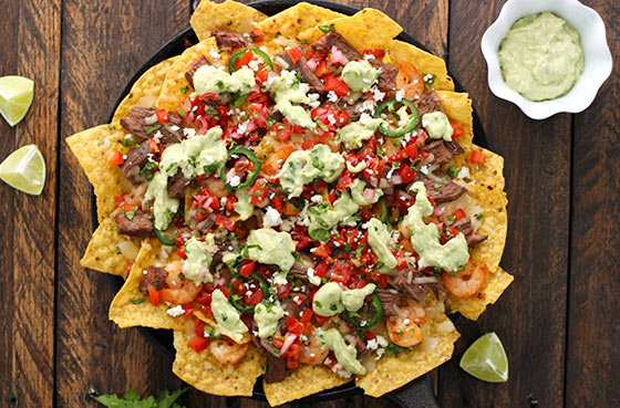Grilled Surf 'n Turf Party Nachos with Avocado Cotija Sauce