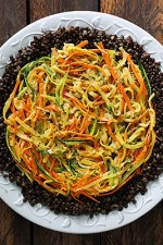 Shoestring Summer Vegetables with Lentils and Smoky Tahini Dressing from SoupAddict.com. A protein-packed side dish with summer squash, zucchini, and carrot shoestrings, served over tasty beluga lentils with a smokey lemon tahini dressing.