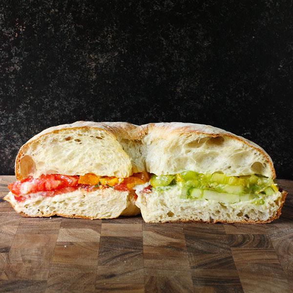 Side view of heirloom tomato sandwich