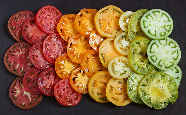 Heirloom Tomato Sandwich with Smoked Corn Mayonnaise from SoupAddict.com - the best tomato sandwich ever, with a beautiful rainbow of heirloom tomatoes and a mind-blowing smoked corn mayonnaise.