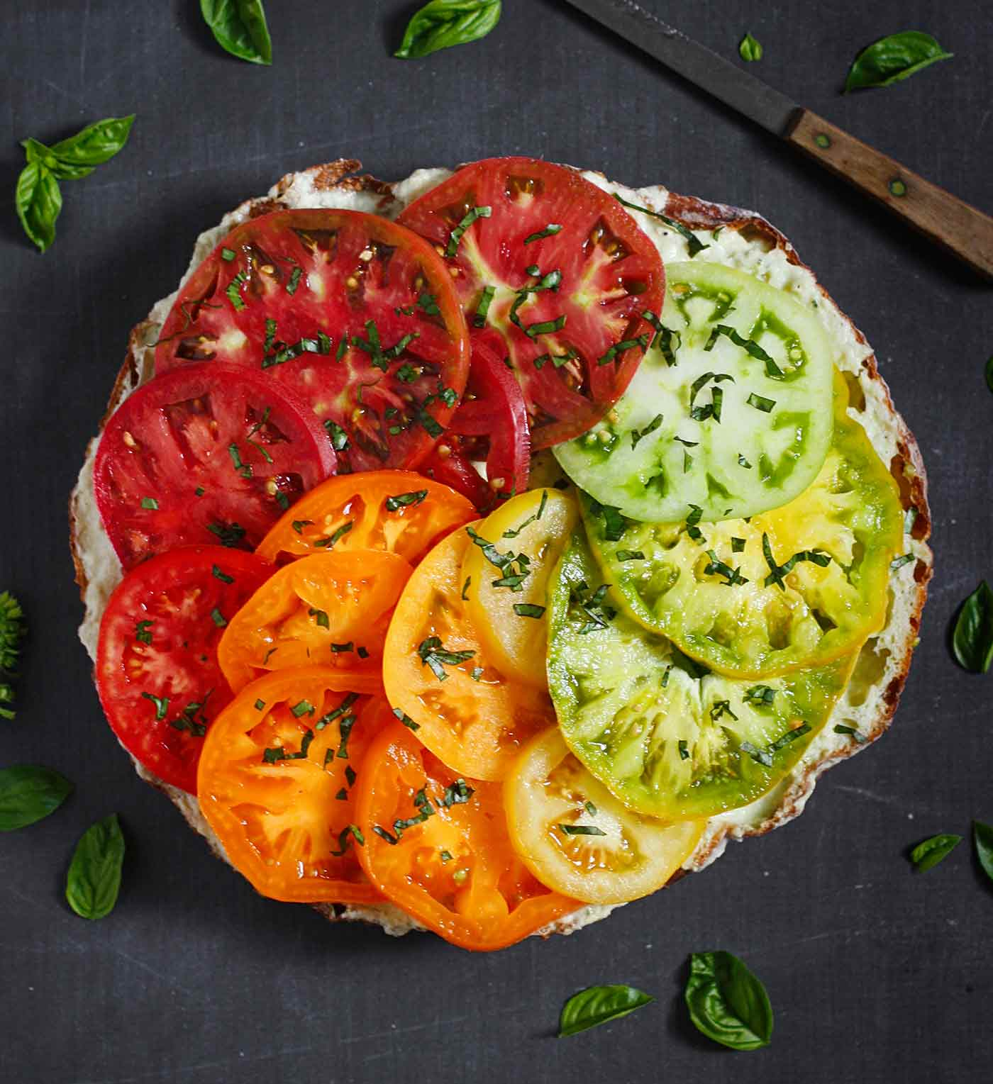 Open-faced heirloom tomato sandwich with rainbow tomatoes