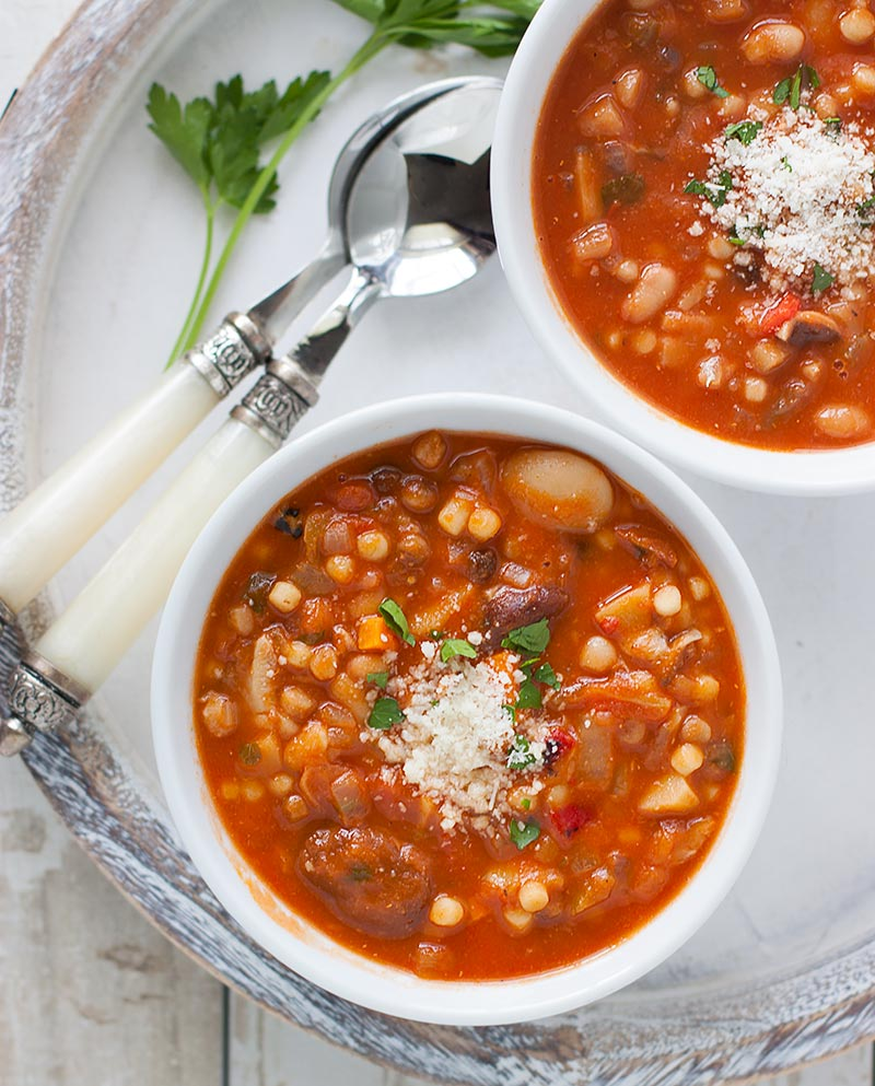 Two bowls of Sardinian Minestrone on a serving tray