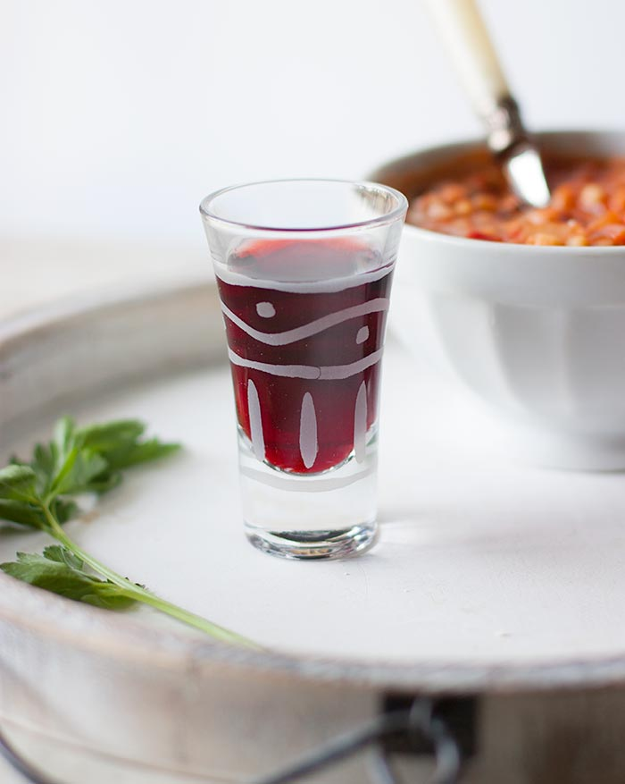 A shot glass with Cannonau red wine