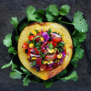 Confetti Stuffed Acorn Squash | SoupAddict.com. Roasted acorn squash stuffed with a rainbow of vegetables makes a healthy, tasty side. Naturally vegetarian, vegan, and gluten-free.