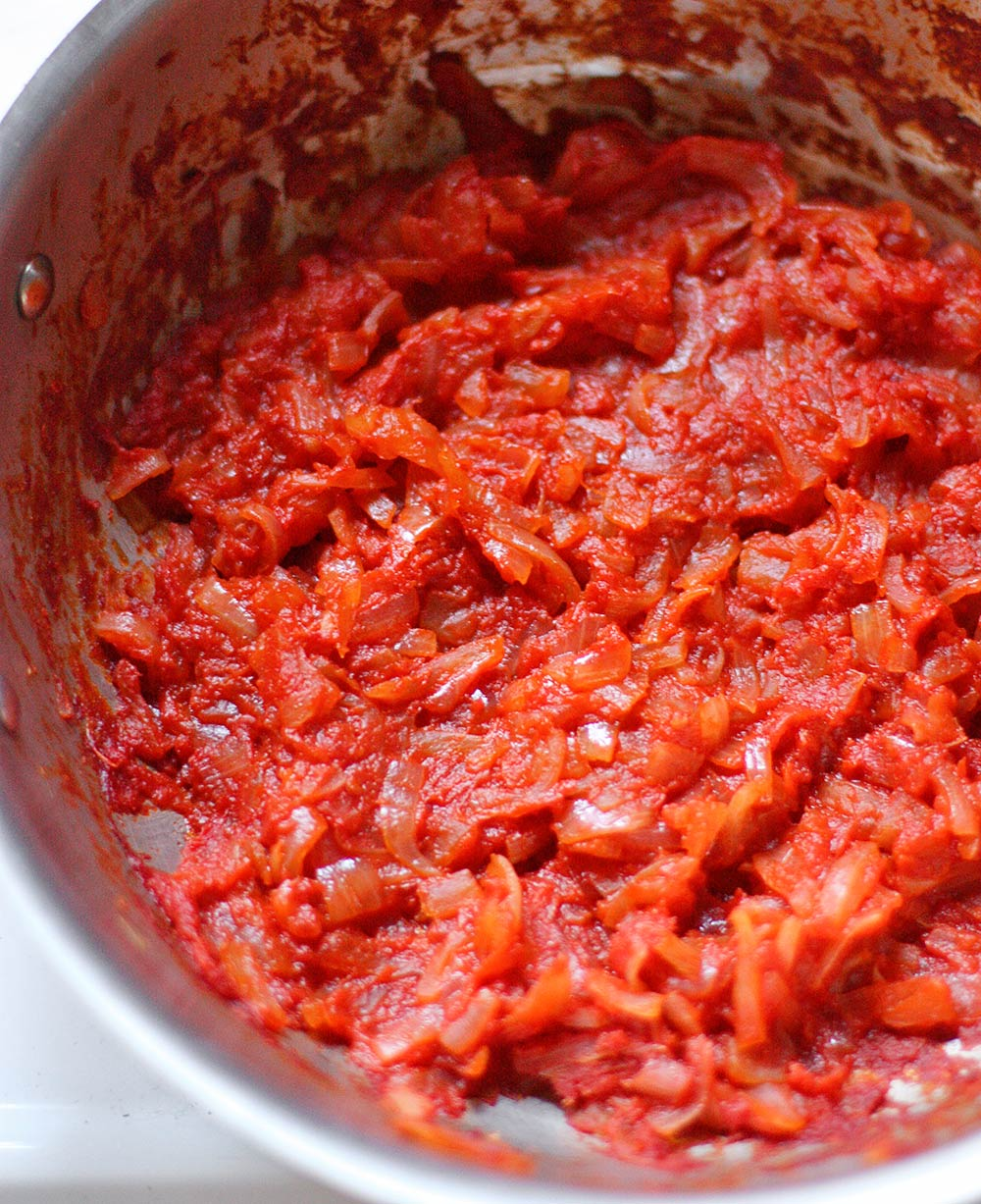 A magical mixture of tomatoes and onions, cooked low and slow until caramelized to sweet-savory perfection! Use in soups, stews, chilis, and more! Get the recipe for Caramelized Tomatoes and Onions at SoupAddict.com