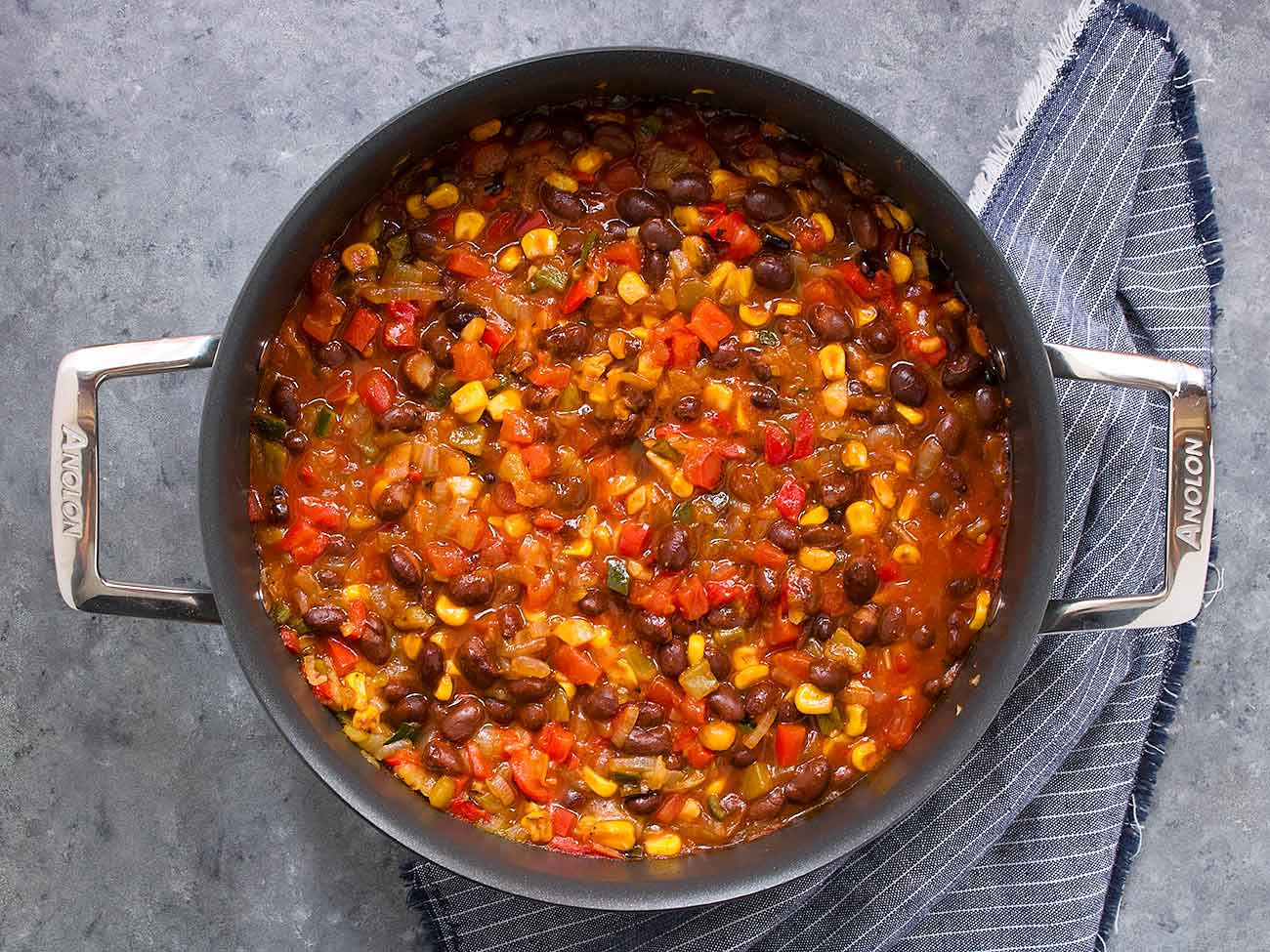 Mexican chili cooking in a pot.
