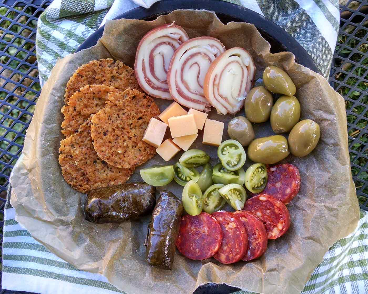 Charcuterie board with pickled green tomatoes