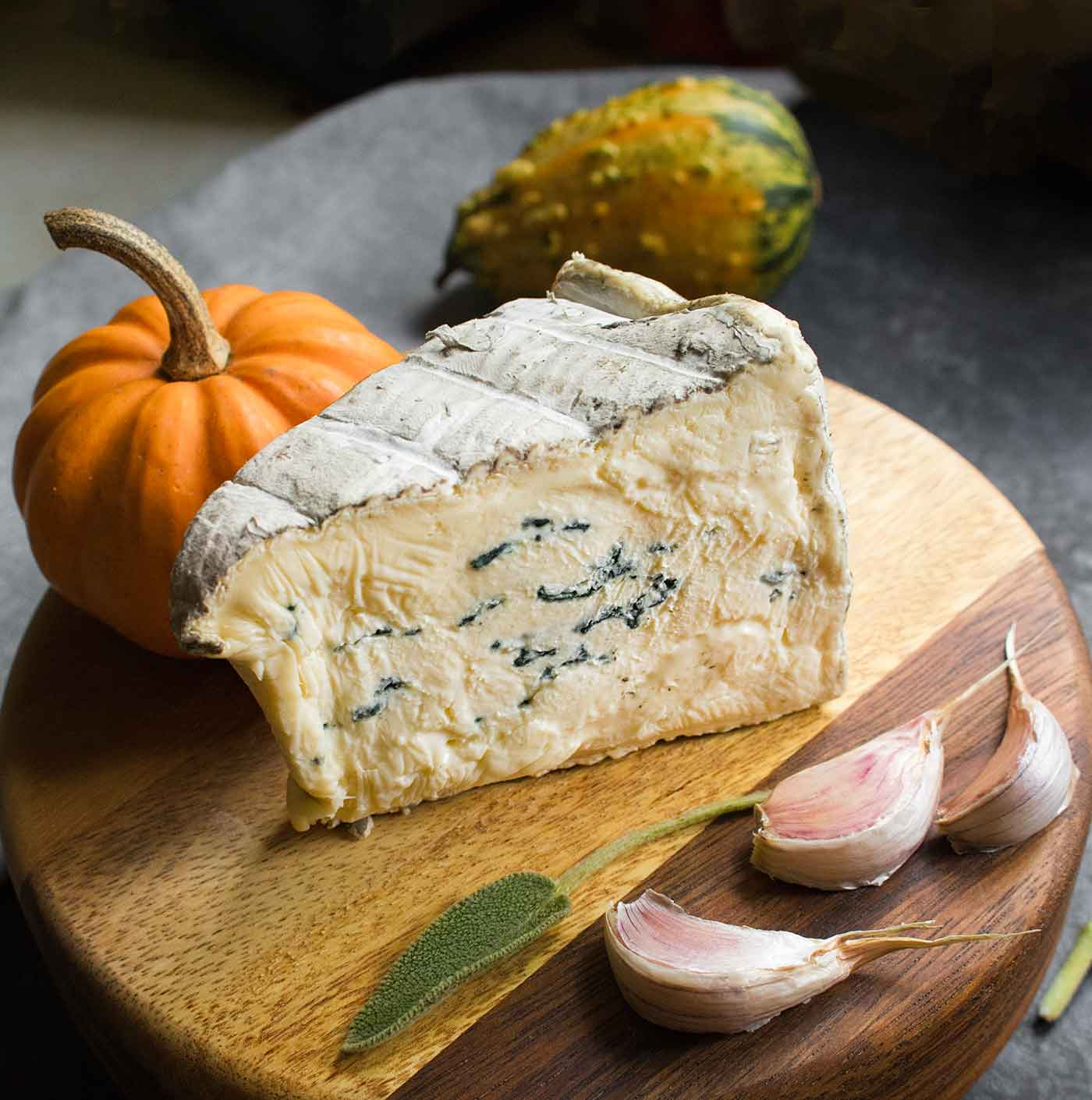 A wedge of Cambozola Black cheese for creamy pumpkin soup