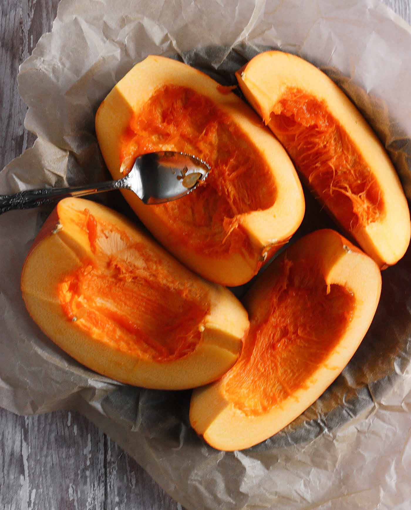 Sliced pumpkin, ready to be roasted for pumpkin puree