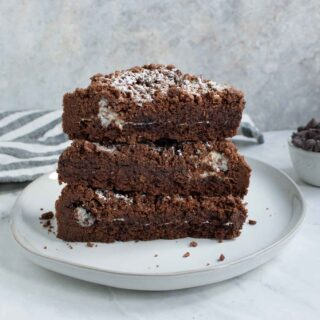 Three Chocolate Marshmallow Shortbread Bars stacked on a plate