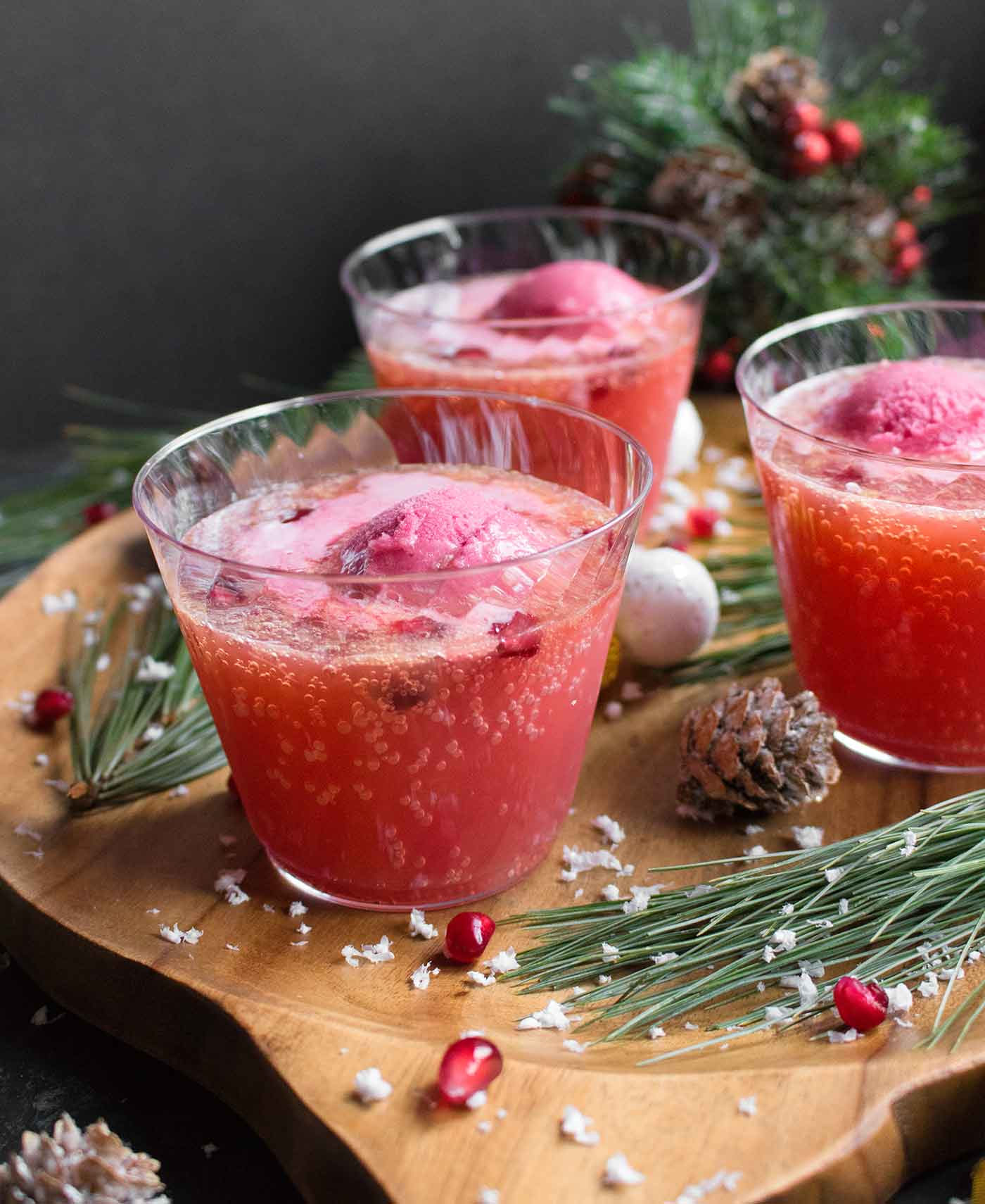 Three cups of Holiday Party Punch, topped with sorbet