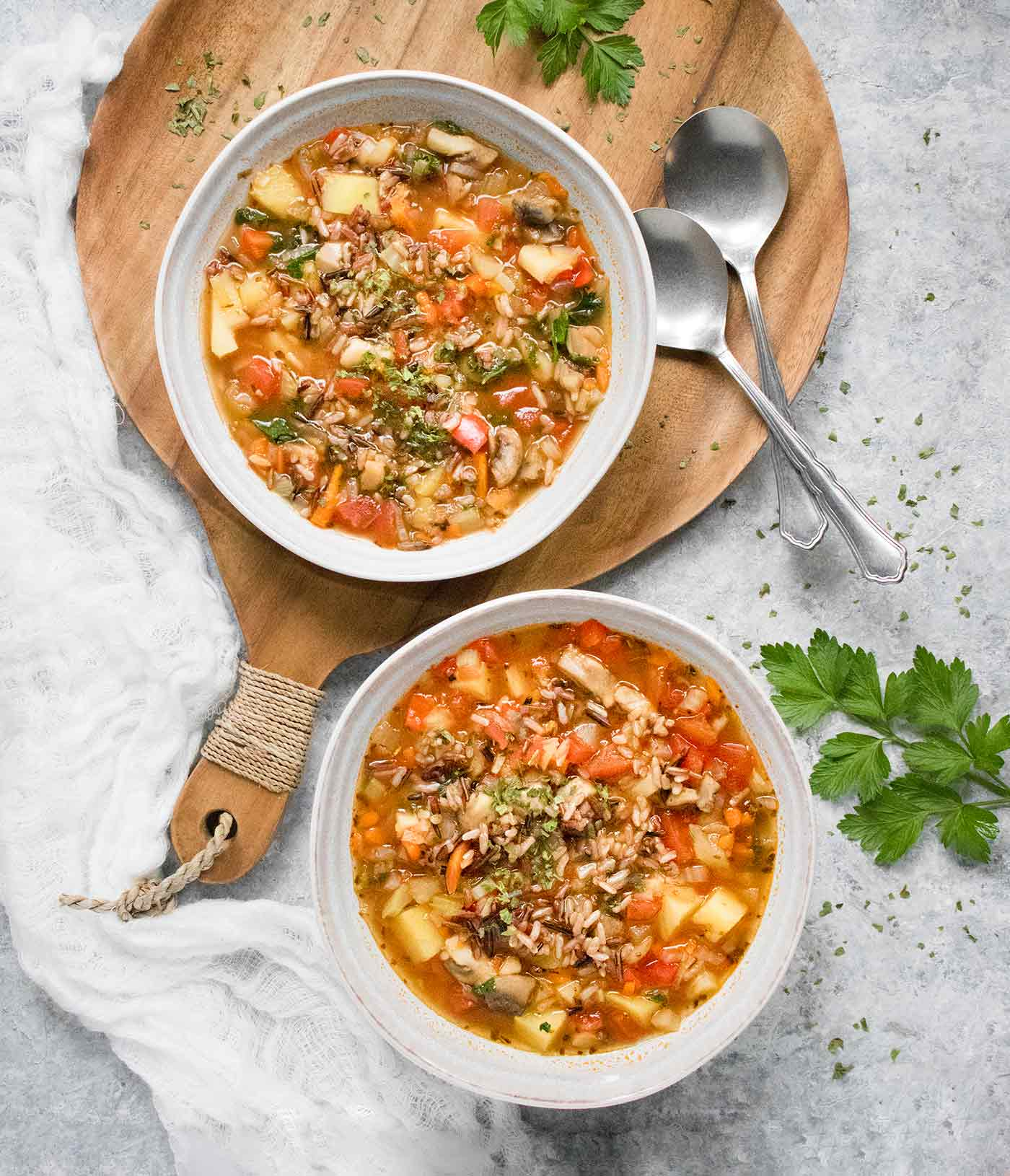 Two bowls of Hearty Vegetable Wild Rice Soup