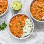 Three bowls of chickpea peanut stew with cauliflower rice blend