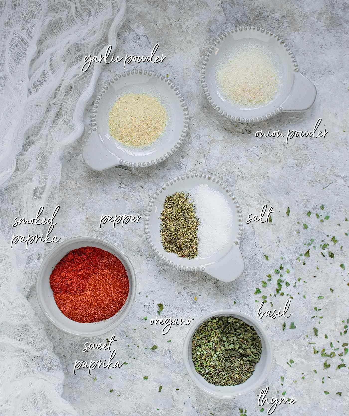 Ingredients of Creole seasoning in pinch bowls