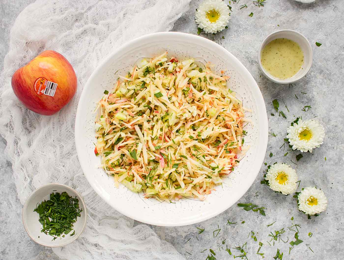 Apple Fennel Slaw made with Autumn Glory Apples, served in a white bowl