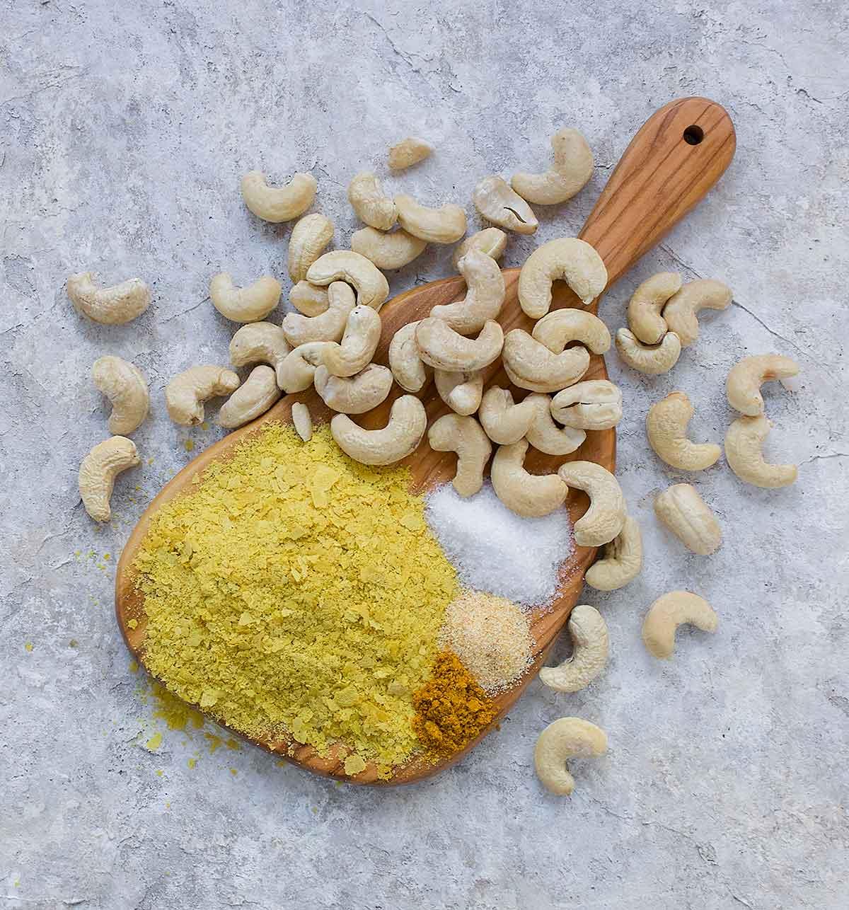 Vegan parm seasoning ingredients on cutting board.