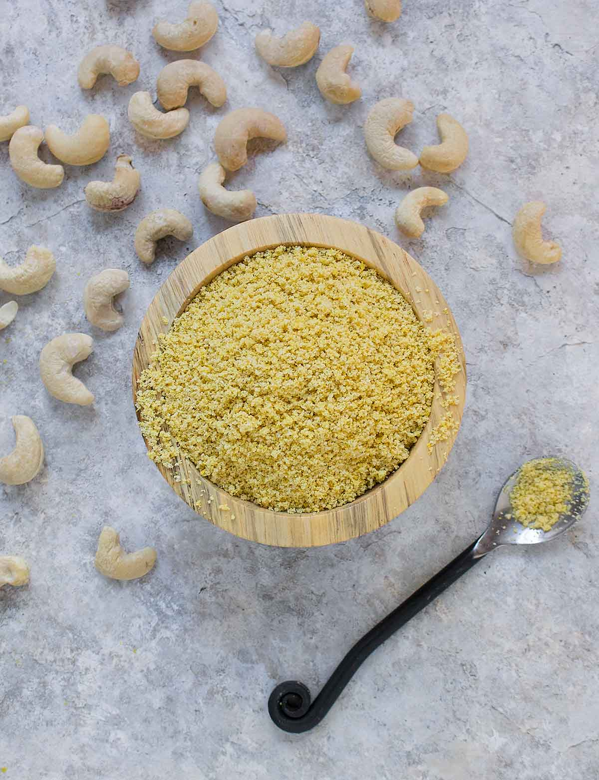Vegan parm seasoning in a bowl with a spoon.