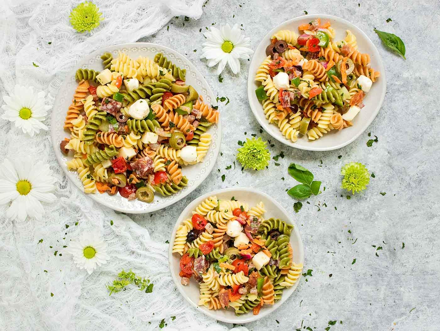 Three plates of pasta salad