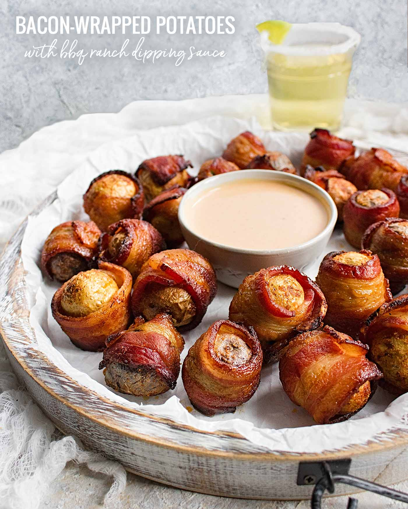 Bacon wrapped baby potatoes on a serving tray