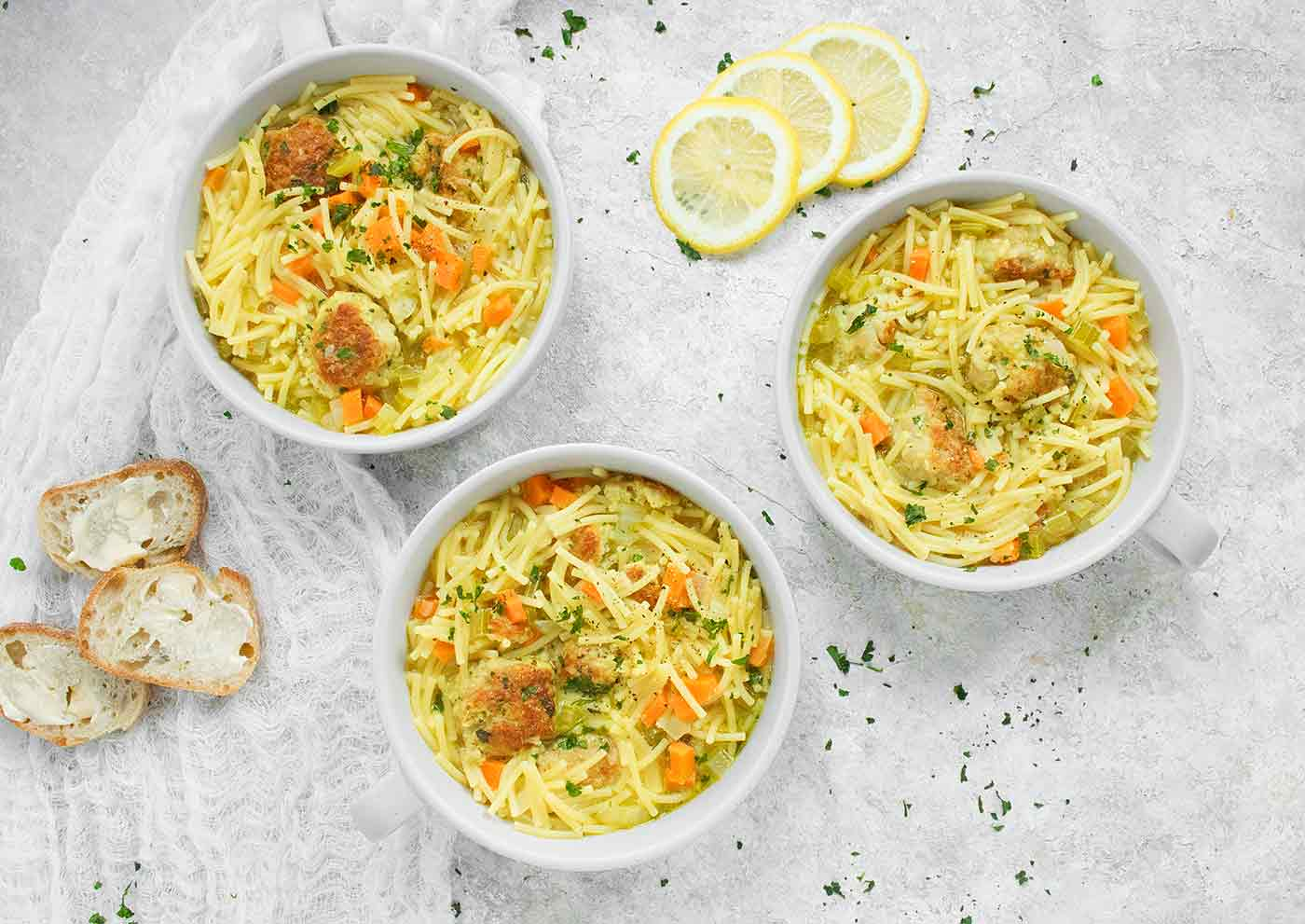 Three bowls of Chicken Meatball Noodle Soup