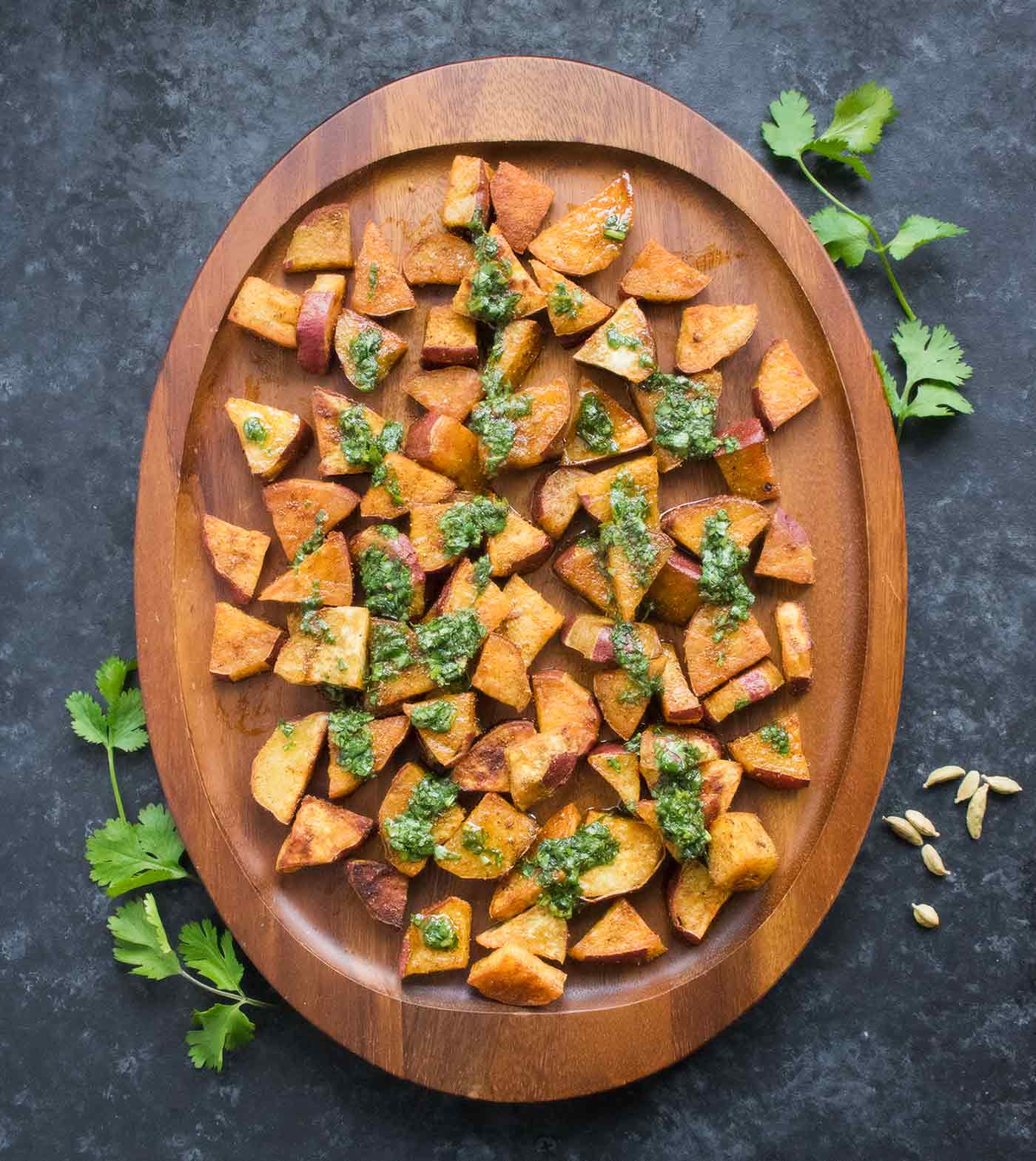 Spiced sweet potatoes on a serving board