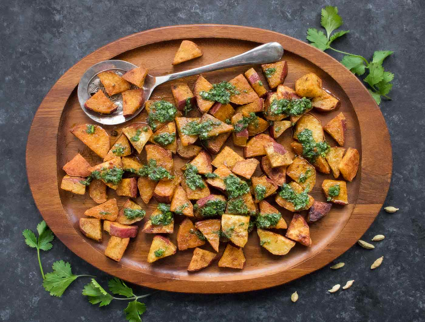 Platter filled with spiced sweet potatoes.