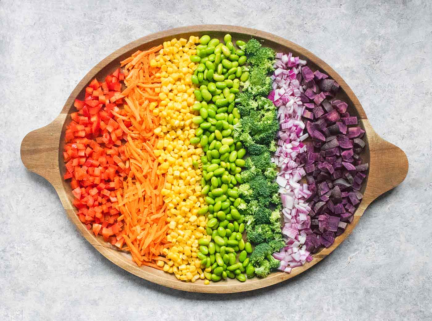 A rainbow of vegetables on a wooden platter