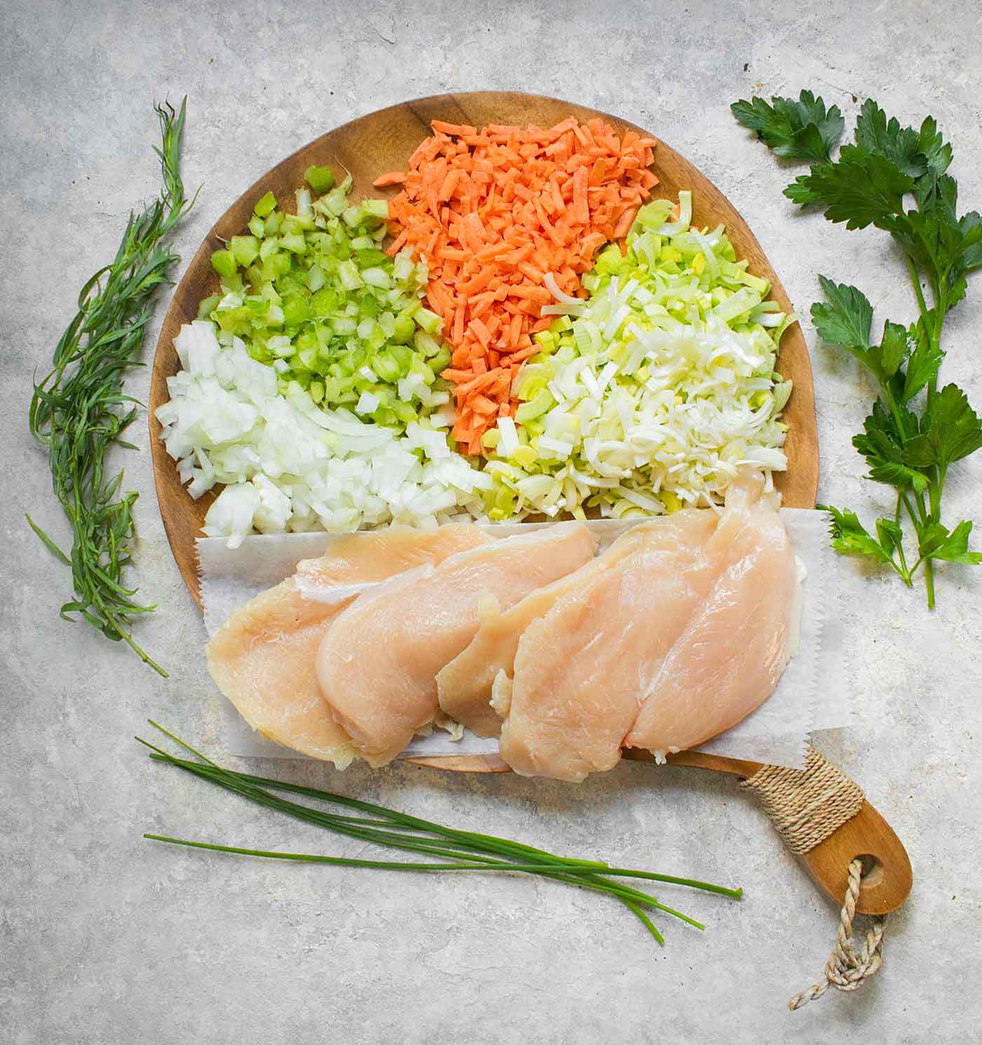 Ingredients for Chicken and Dumplings on a wooden cutting board