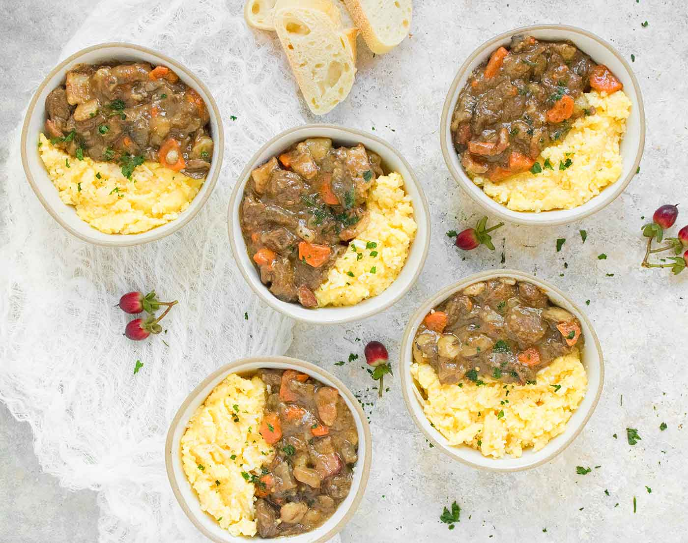 Five bowls of Dijon Beef Stew with Cheese Grits