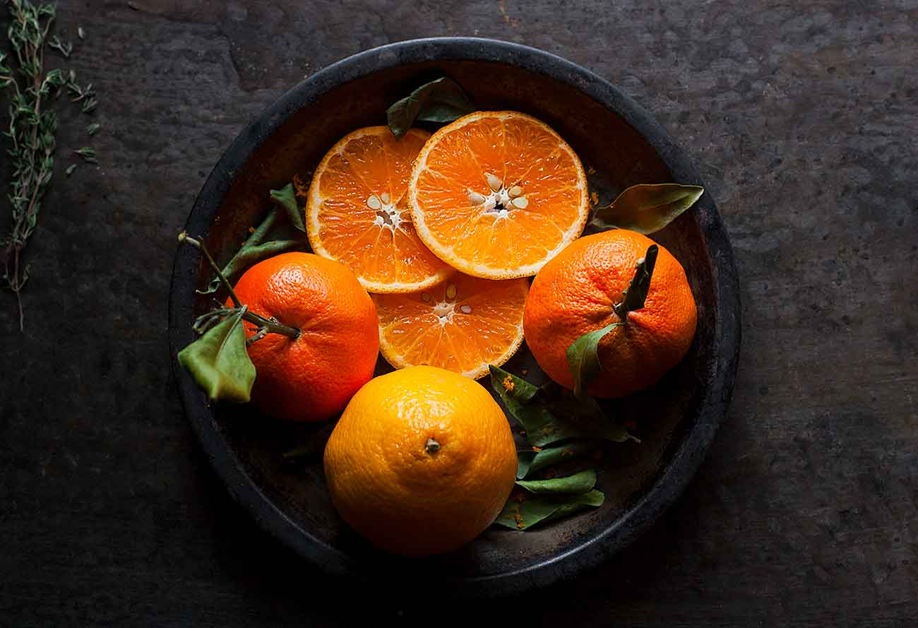 Clementines and tangerines on a plate