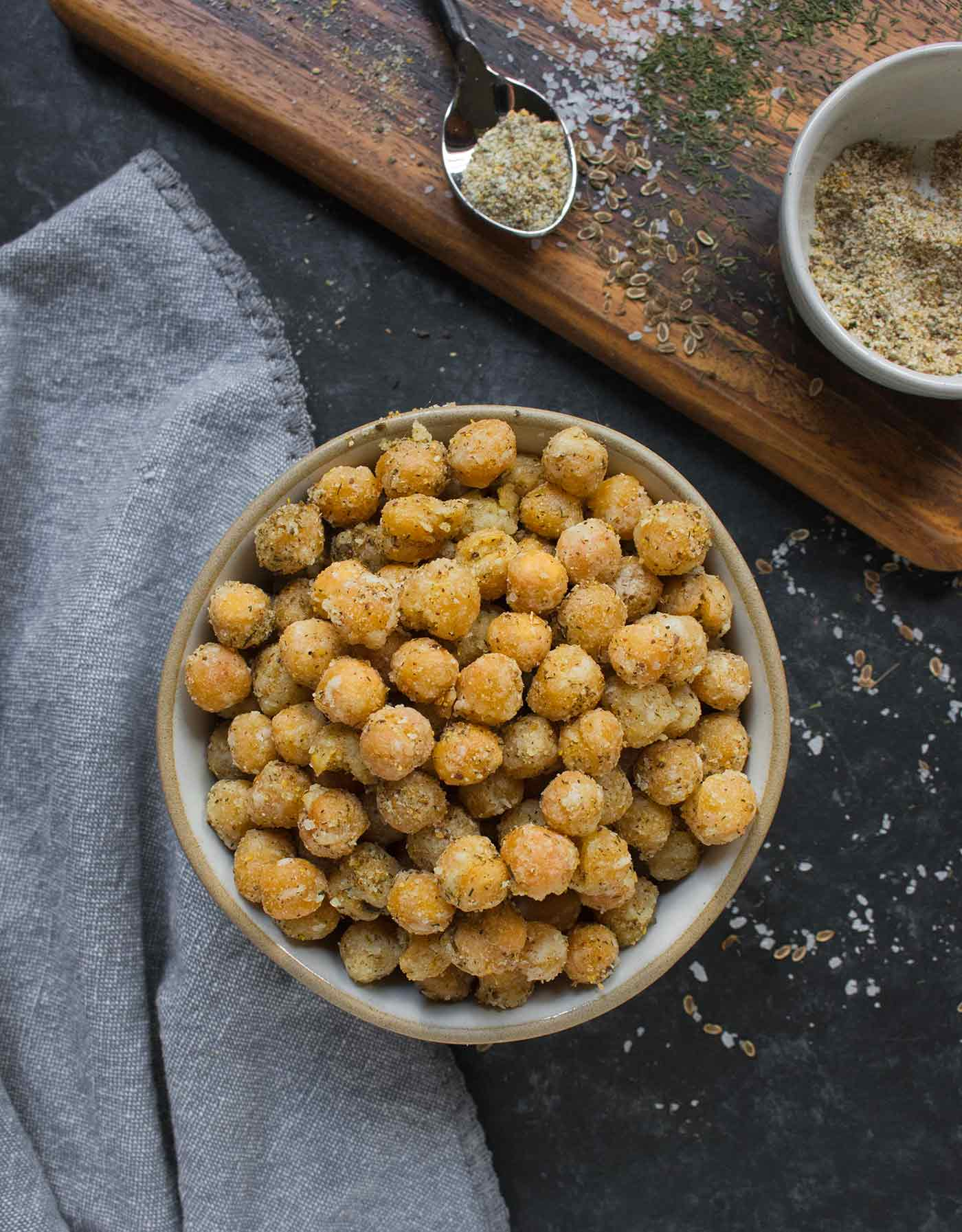 Crispy-fried Dill Pickle Chickpeas in a bowl, with seasonings