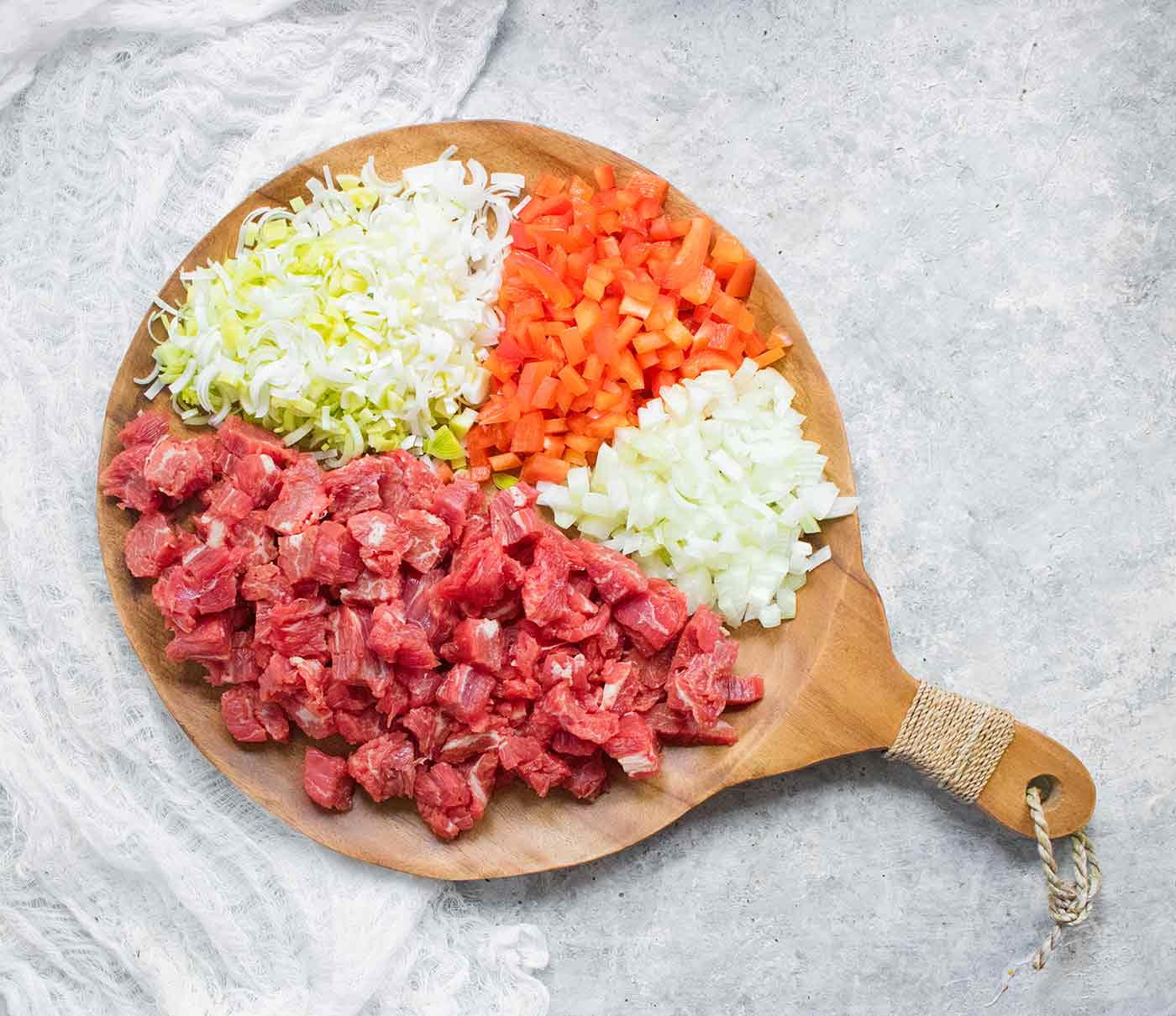 Ingredients for Mongolian Beef Soup on a round wooden serving board
