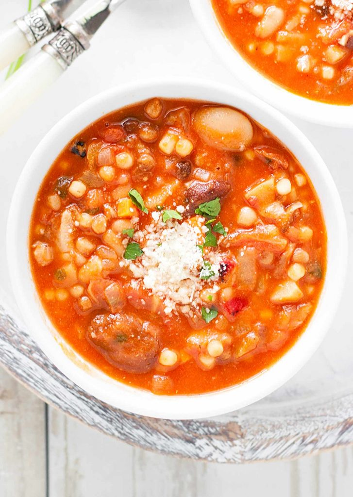 A white soup bowl filled with Sardinian Longevity Minestrone